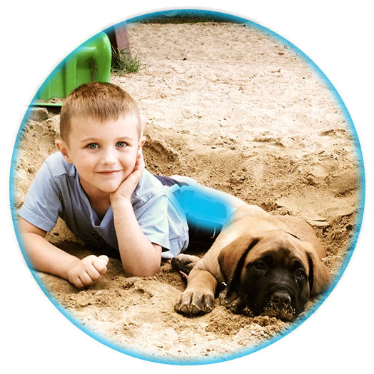SoHo Kid with Puppy in the Sand